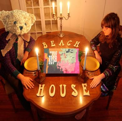 Beach House's Victoria Legrand sitting down with a teddy grizzly bear